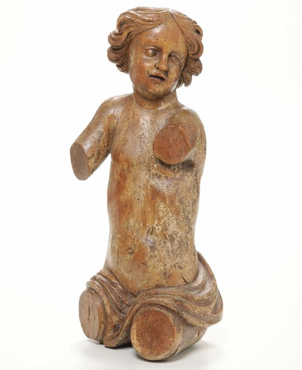 A ligneous fragment depicting a putto. Baroque sculptor from the 17th century