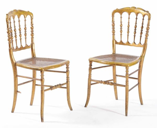 A pair of gilt wood chairs, 20th century