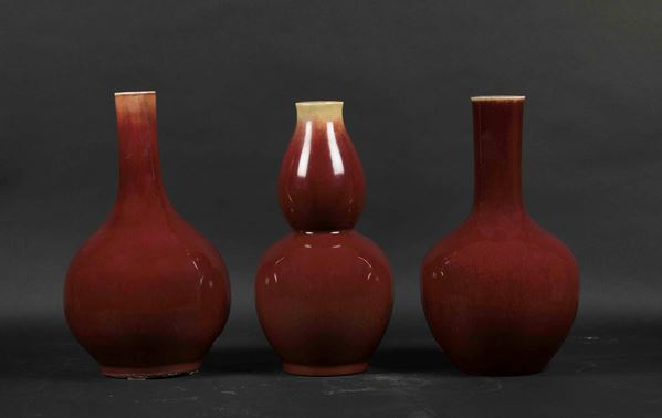 Three oxblood monochrome porcelain vases in various shapes, China, Qing Dynasty, 19th century