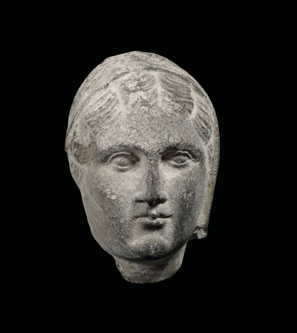 A female face in stone. Sculptor from beyond the Alps active in the 15th century