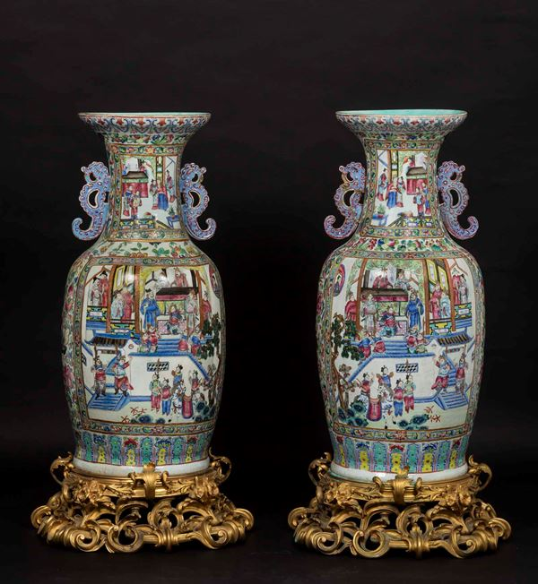 A pair of large Canton porcelain vases depicting everyday life scenes on gilt bronze backdrops with  [..]