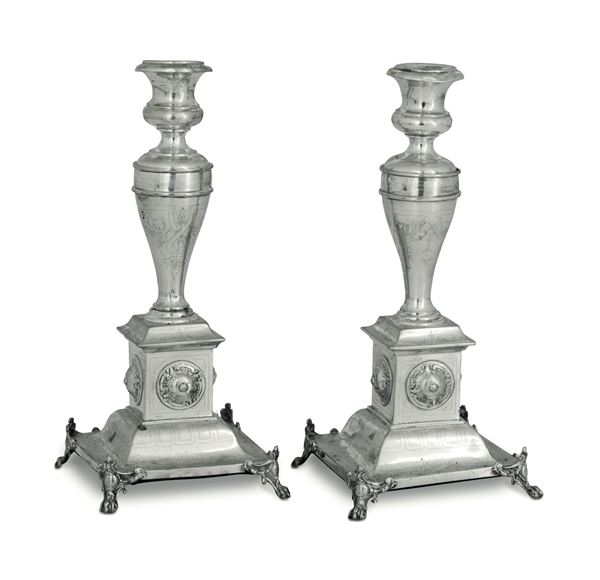 A pair of candlesticks in molten, embossed and chiselled silver. Austro-Hungarian manufacture from the 19th century