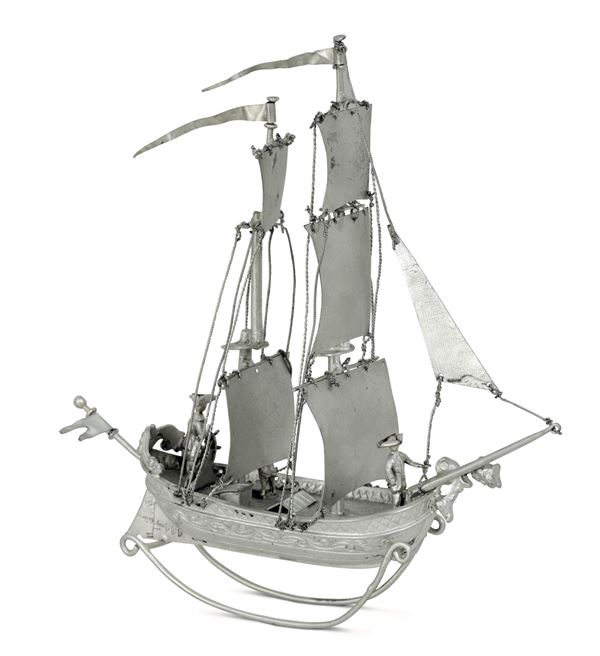 A model of a sailing ship in molten, embossed, chiselled and perforated silver. London, 20th century
