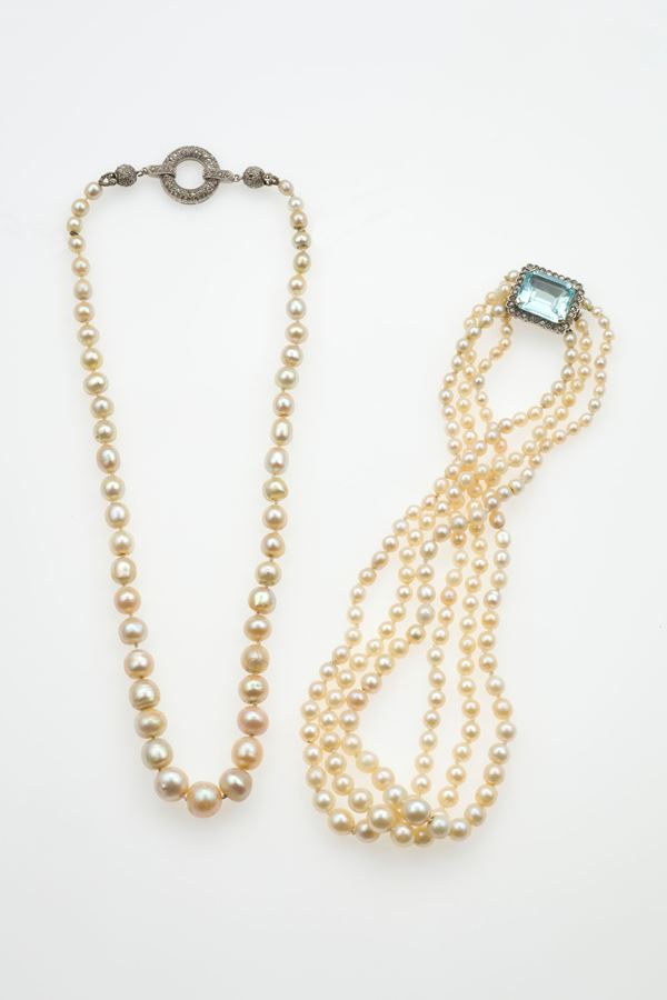 One natural pearl and platinum necklace and  three strand of pearls necklace, one of these is natural pearls