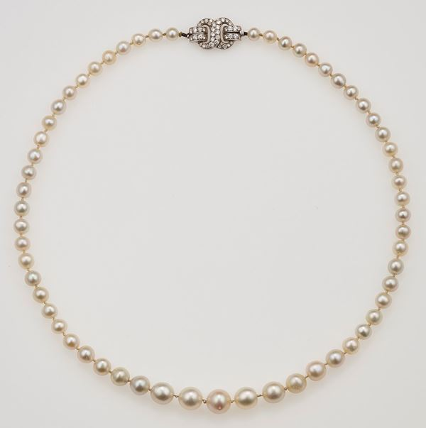 Natural pearl necklace. Designed as a graduated row of fifty-nine natural pearls