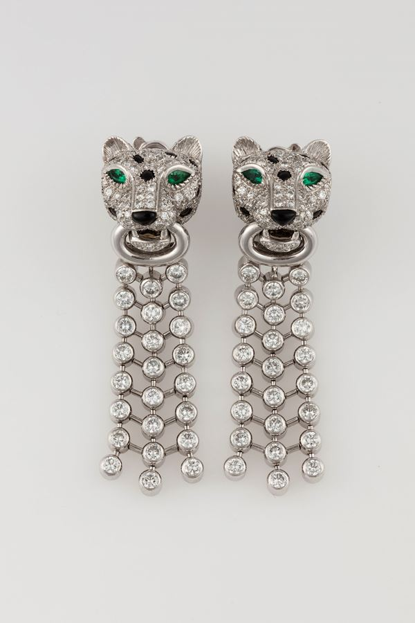Pair of diamond, emerald, onix and platinum pendent earrings. Signed Cartier???
