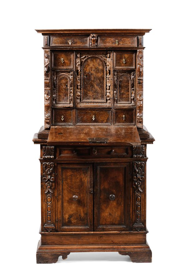 A cabinet with ancient elements