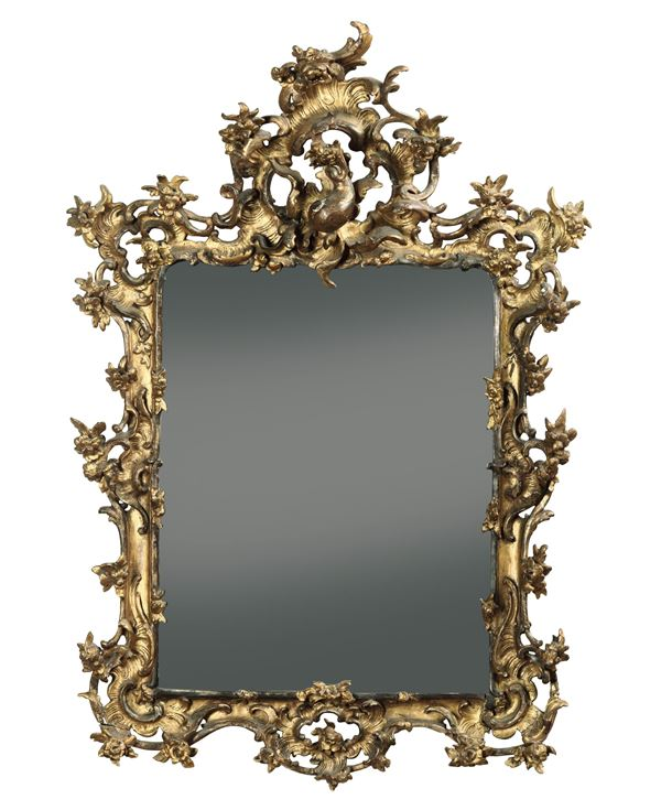 A carved and gilt wood mirror, 1700s