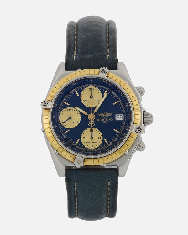 Breitling, Chronomat, Ref. D13050. Fine, self-winding, water-resistant, stainless steel and 18K yellow gold  wristwatch with date, round button chronograph, registers, tachometer and a stainless steel Breitling buckle. Made circa 1990
