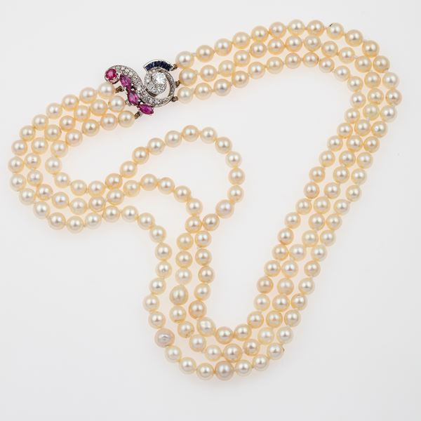 Cultured pearl necklace with gold, ruby, sapphire and diamond clasp
