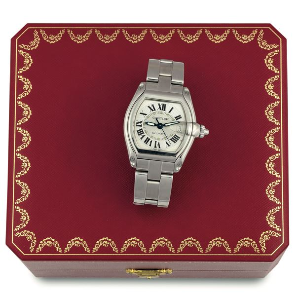 Cartier, Roadster Automatic, Ref. 2510. Fine, tonneau-shaped, curved, center seconds, self-winding, water-resistant, stainless steel wristwatch with date and quick change stainless steel Cartier bracelet with double deployant clasp. Accompanied by the original fitted box, Guarantee and instruction booklet. Made circa 2000's