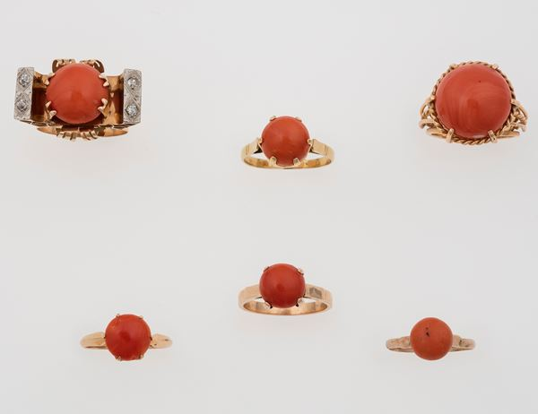 Six coral and gold rings