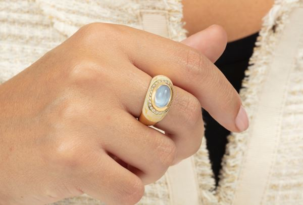 Enamel, diamond and moonstone ring. Signed Fabergé. Fitted case. Certificate of authenticity