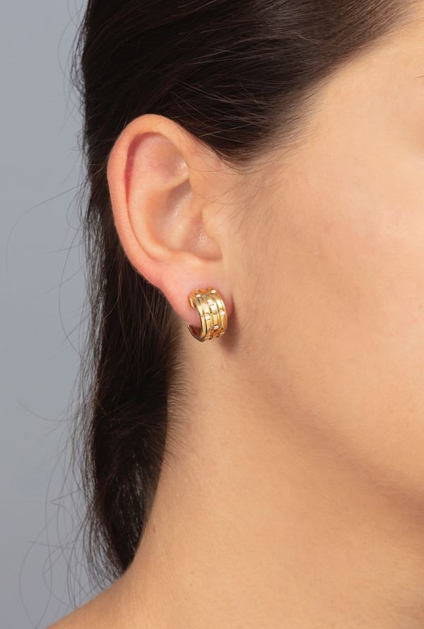 Pair of diamond and gold earrings. Signed Piaget