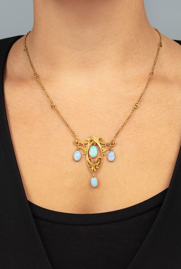 Opal and low carat gold necklace