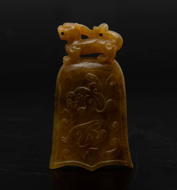 A carved jade bell, China, 1900s