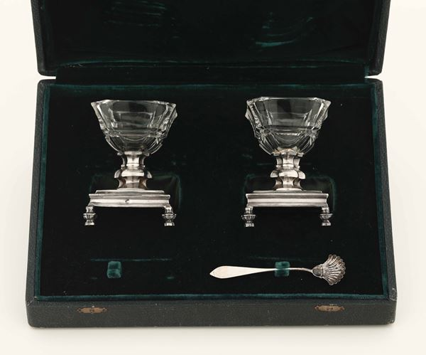Two silver salt cellars in a case, France
