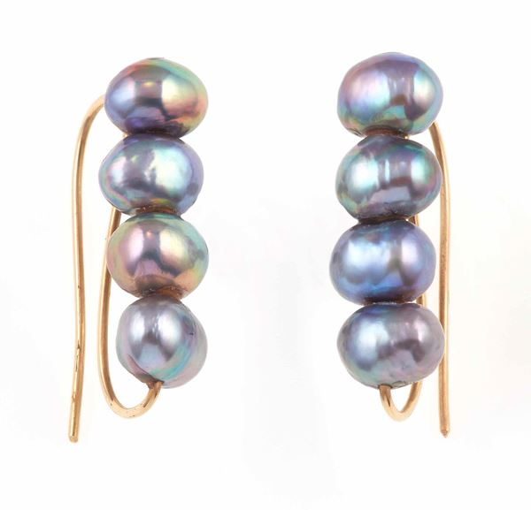 Pair of pearl and gold earrings