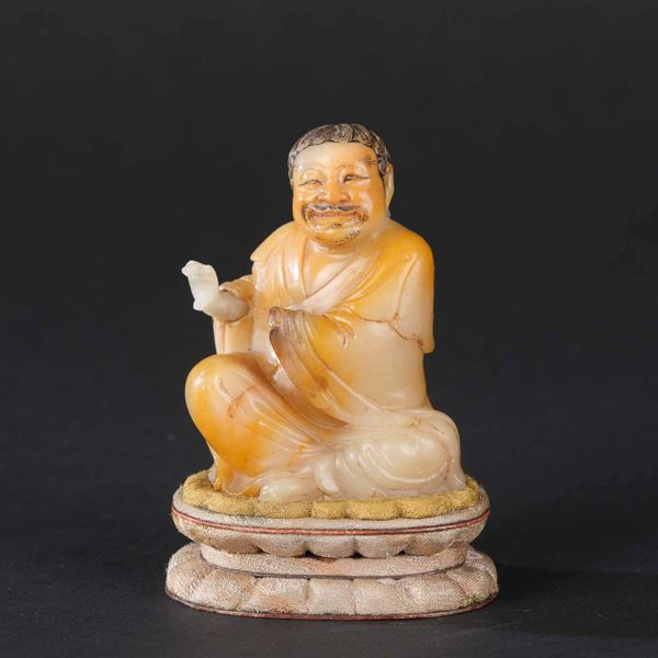 A soapstone figure, China, Qing Dynasty