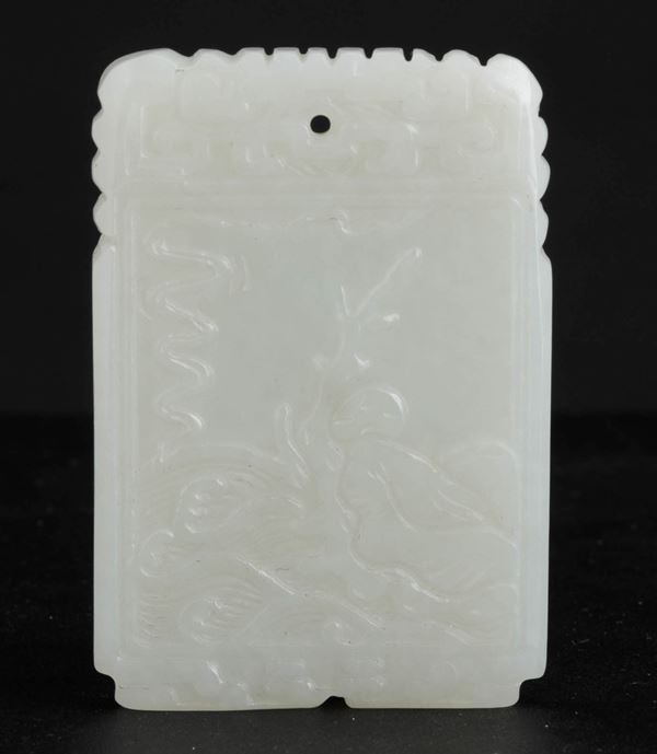 A carved jade pendant, China, Qing Dynasty