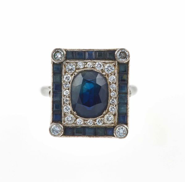 Sapphire and diamond ring and a pair of earrings
